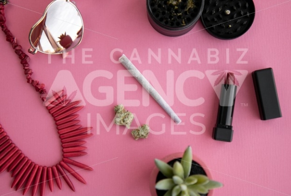 Festival Herbal Remedy on Pink with Red Necklace and Heart Sunglasses – Top Down - Cannabis Royalty Free Stock Images