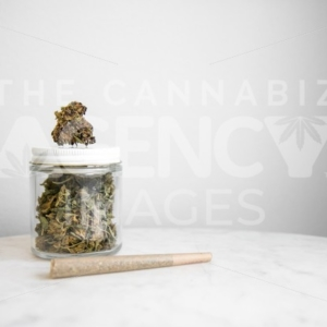 TCA Images jar of weed on marble table