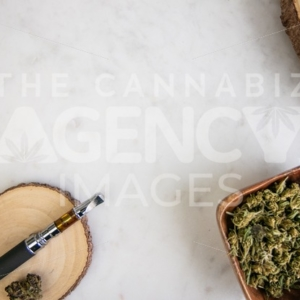 Pen, Flower and Reclaimed Wood Accessories on White Marble - Cannabis Royalty Free Stock Images