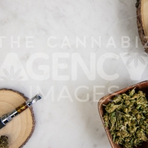 Pen, Flower and Reclaimed Wood Accessories on White Marble – Top Down - Cannabis Royalty Free Stock Images
