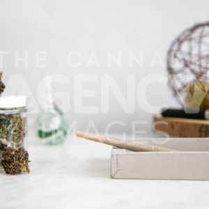 Pen on Wooden Tray, Flower Buds, Glass and Roll on White Marble - Cannabis Royalty Free Stock Images