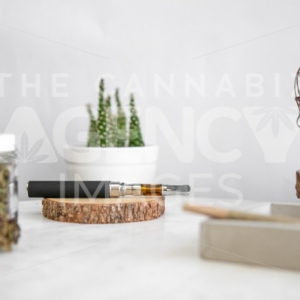 Products on Wooden Tray, Flower, and Cactus – Pen In Focus - Cannabis Royalty Free Stock Images