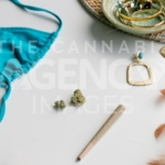 Summer Festival Essentials Blue Bikini and Gold on Light Blue – Angled - Cannabis Royalty Free Stock Images