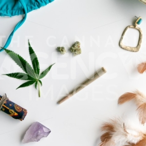 Summer Festival Essentials Blue Bikini and Gold on White – Top Down - Cannabis Royalty Free Stock Images